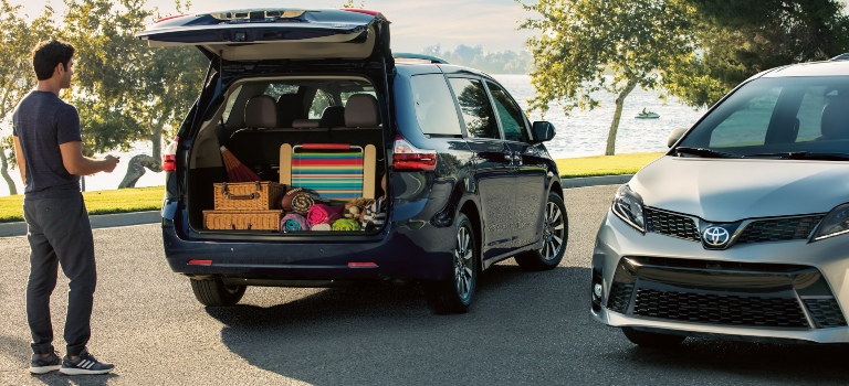 2020 Toyota Sienna black back view loaded with cargo