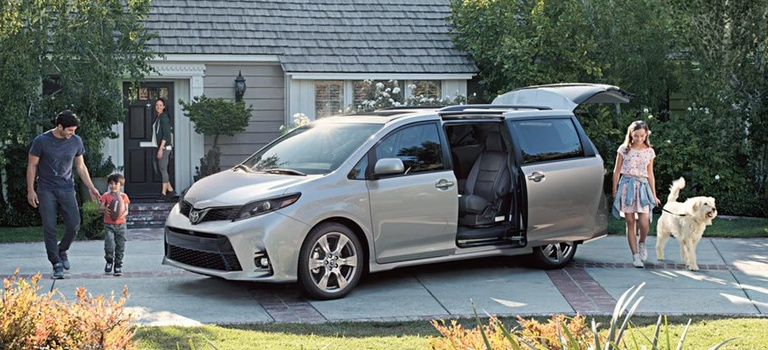2020 Toyota Sienna silver side view with family