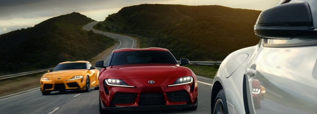 2020 Toyota GR Supra front view on the road three models
