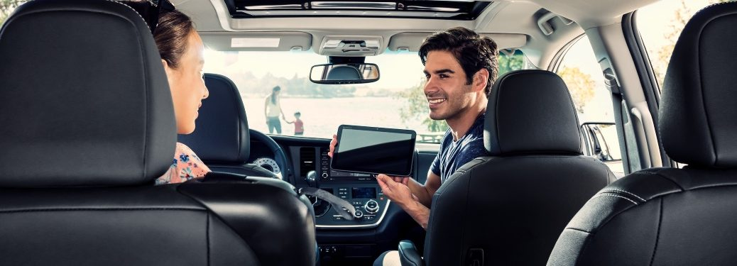 2020 Toyota Sienna front seats with man holding a tablet