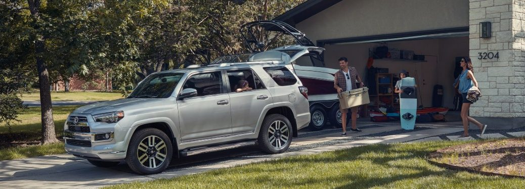 family loading up a silver 2020 Toyota 4Runner
