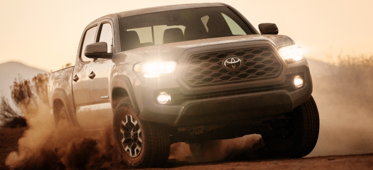 2020 Toyota Tacoma front view in the sand