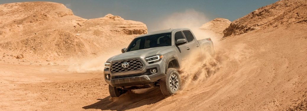 2020 Toyota Tacoma gray going down sand