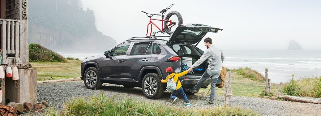 2020 Toyota RAV4 back side view with family on the coast