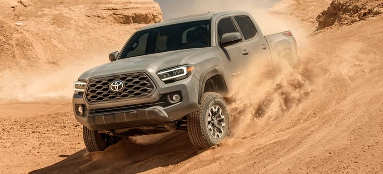 2020 Toyota Tacoma driving through sand