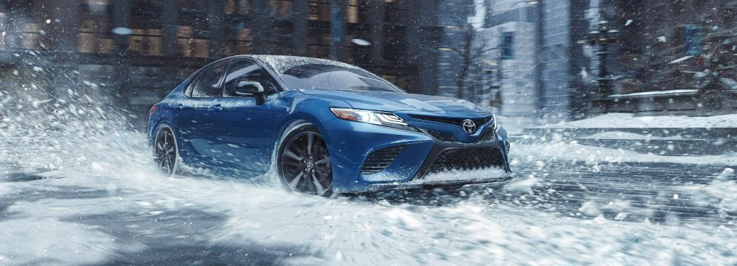 2020 Toyota Camry blue in snow