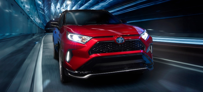 2021 Toyota RAV4 Prime red front view in a tunnel