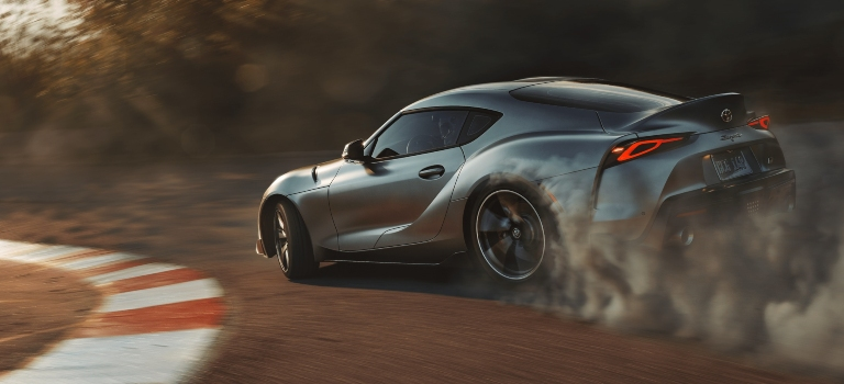 2020 Toyota GR Supra gray side view burning rubber