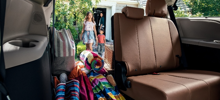 2020 Toyota Sienna family coming in view through back with cargo