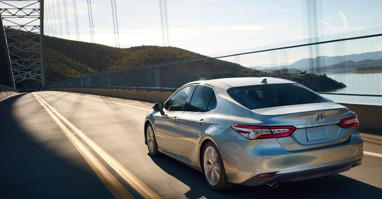 2020 Toyota Camry silver back view on road
