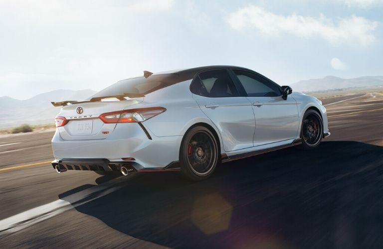 Exterior view of the rear of a white 2020 Toyota Camry TRD