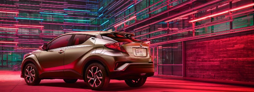 2021 Toyota C-HR rear fascia driver side parked in room with LED colored lights