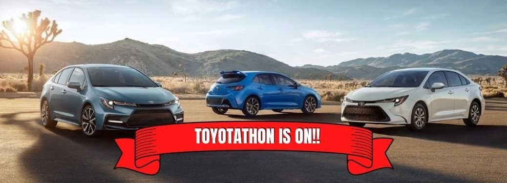 three toyota corollas and toyotathon is on banner