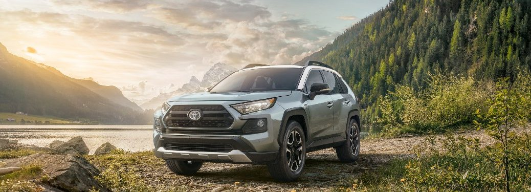 2021 Toyota RAV4 front fascia parked near river in forest with hills and mountains
