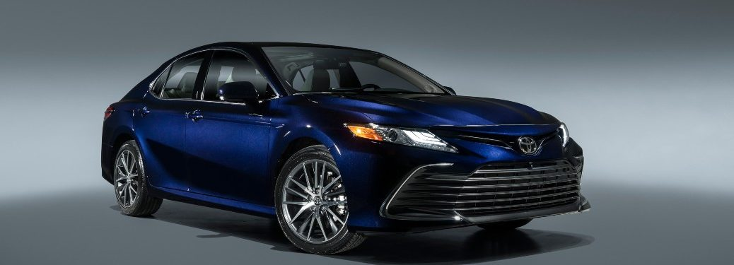 2021 Toyota Camry blue exterior front passenger fascia parked in white room