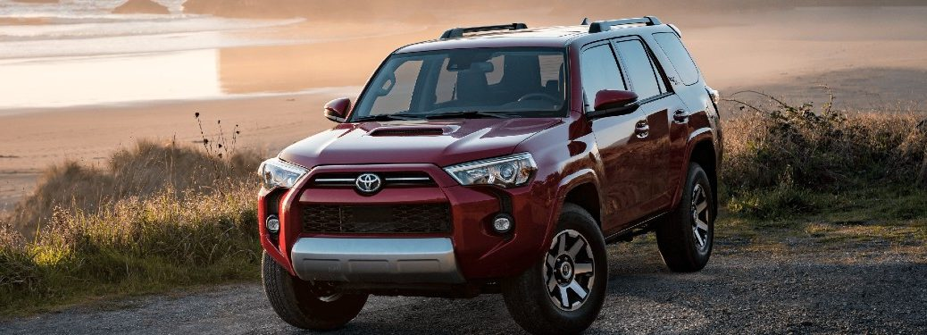 2021 Toyota 4Runner red exterior front driver side fascia parked on gravel next to beach