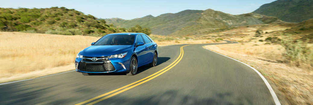 Blue 2016 Toyota Camry Driving
