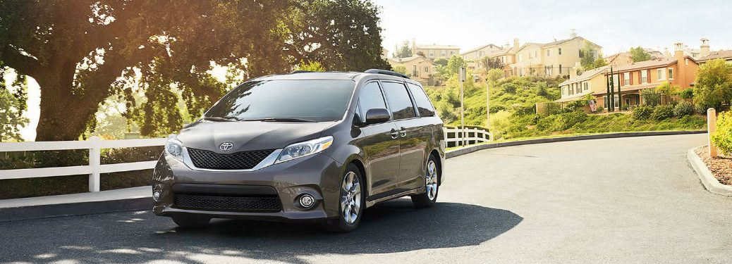 2017 Toyota Sienna minivan driving down road on sunny day
