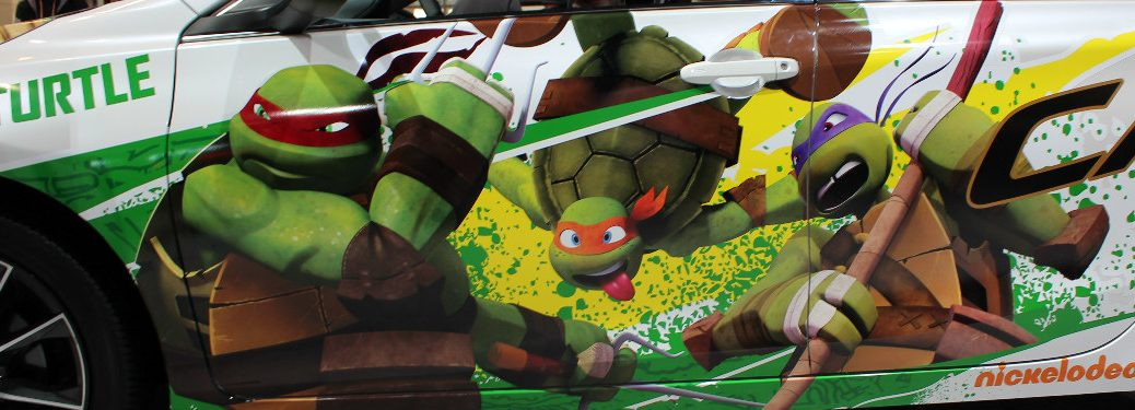 Raphael Michelangelo and Donatello from TMNT on Toyota Camry at Chicago Auto Show