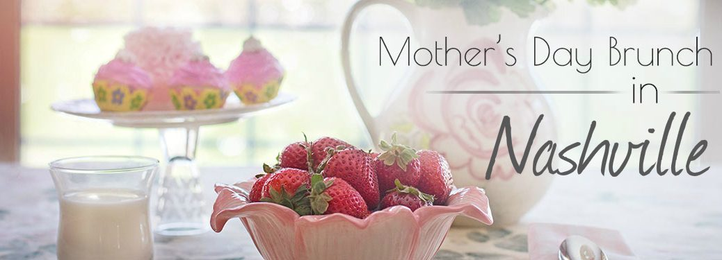 strawberries and muffins and a white picture set on a table