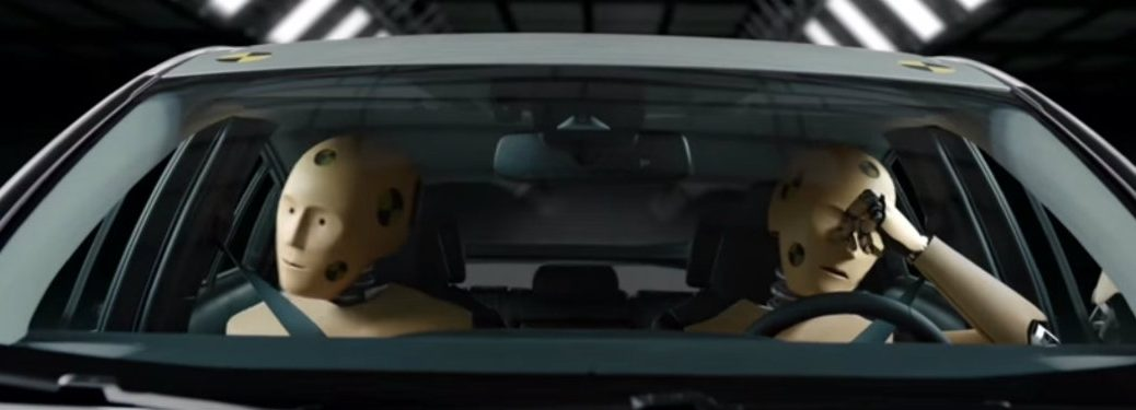 Toyota crash test dummies in car seen through windshield from TV ads