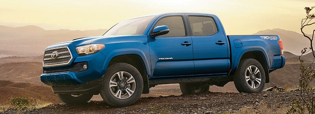 blue 2017 Toyota Tacoma on a rocky hilltop exterior driver side view
