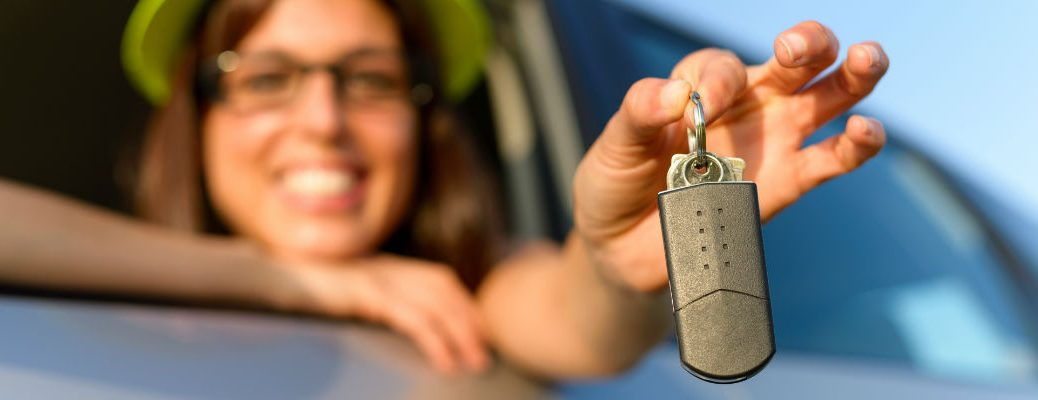 Woman showing off new key fob