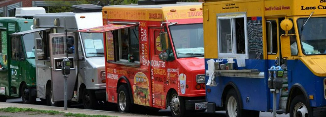 food trucks parked on the street lined up