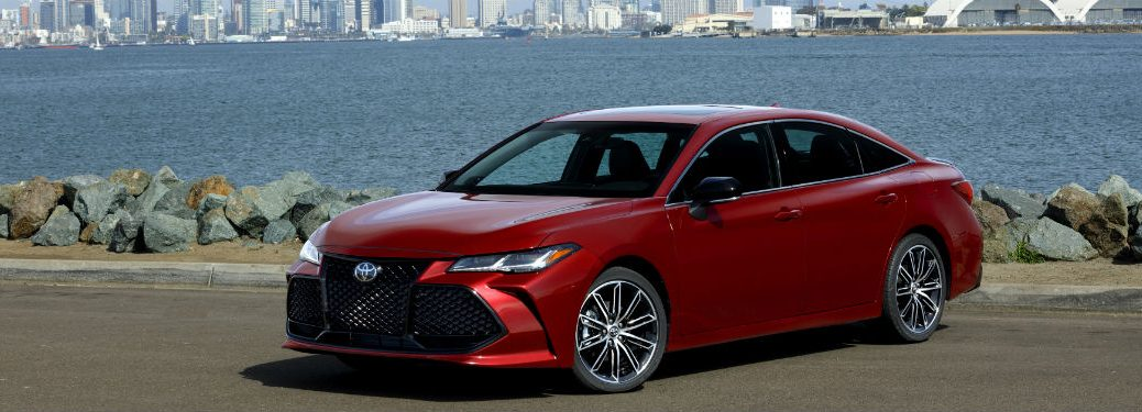2019 Toyota Avalon exterior front fascia and drivers side parked in front of water and city