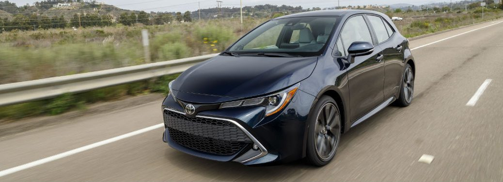 2019 Toyota Corolla Hatchback exterior front fascia and drivers side on road