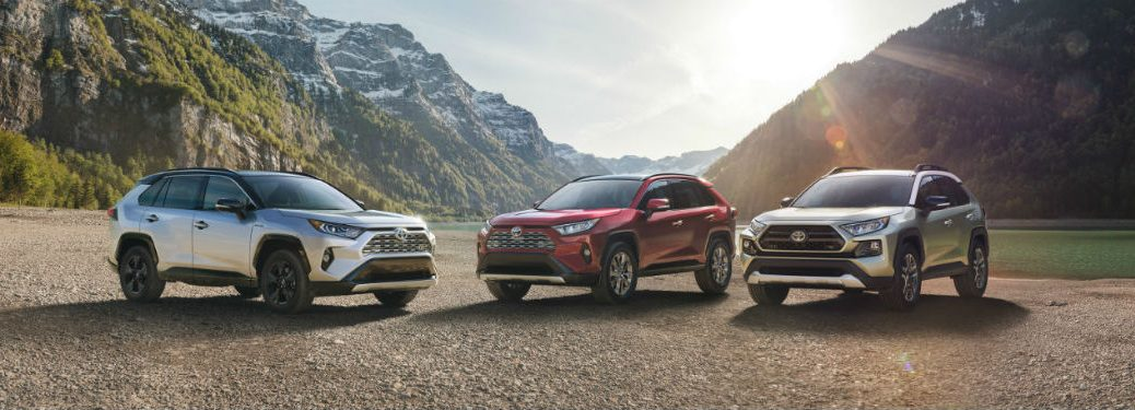 3 2019 Toyota Rav4 Exterior front fascia 2 drivers side 1 passenger side in valley with sun shining