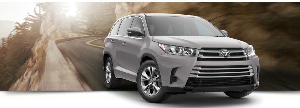 2018 Toyota Highlander LE exterior front fascia and passenger side going fast on road
