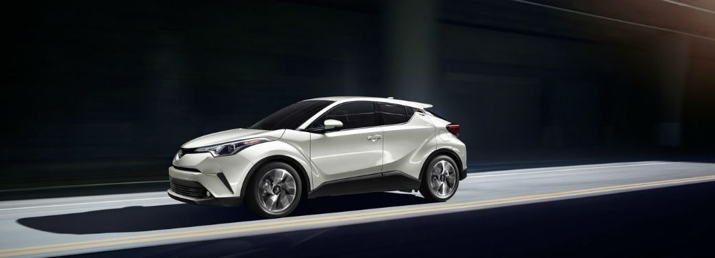 2019 Toyota C-HR exterior front fascia and drivers side on road with dramatic lighting
