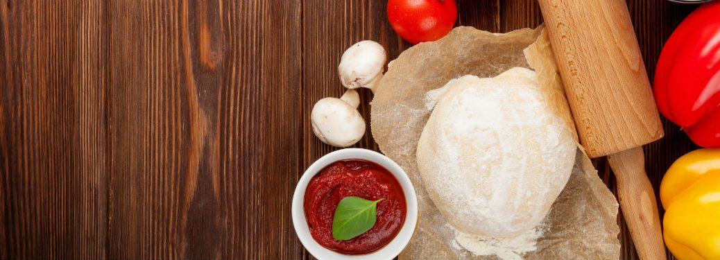 Pizza cooking ingredients and rolling pin