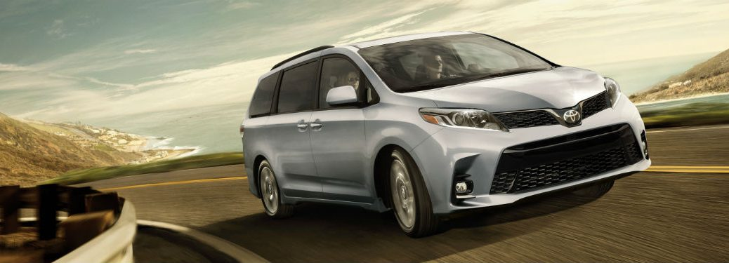 2018 Toyota Sienna exterior front fascia and passenger side going fast on blurred road