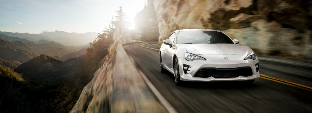 2019 Toyota 86 exterior front fascia and passenger side going fast on mountain road