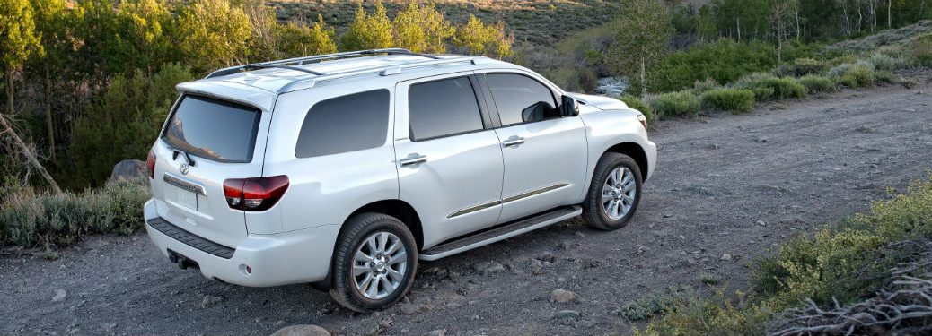 2019 Toyota Sequoia exterior back fascia and passenger side on forest dirt road