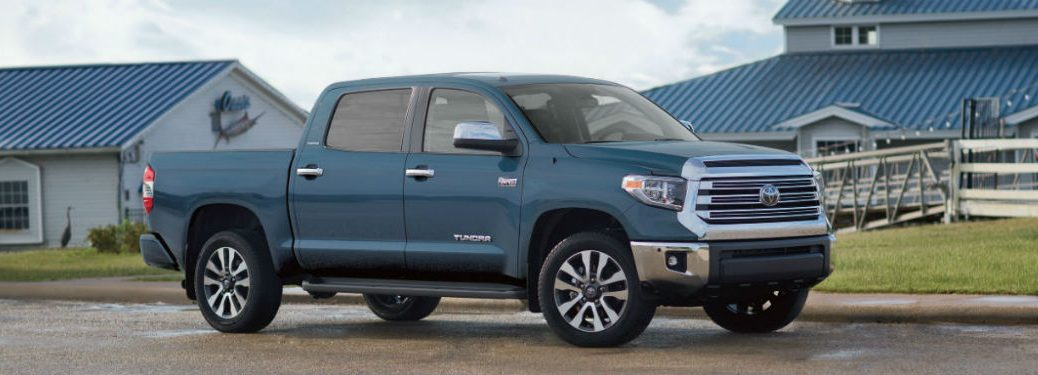 2019 Toyota Tundra exterior front fascia and passenger side parked outside of houses