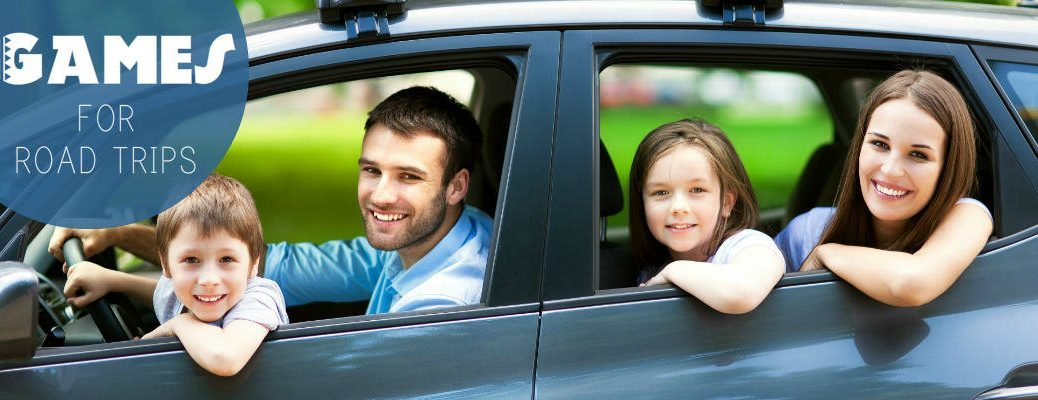family smiling out windows of car