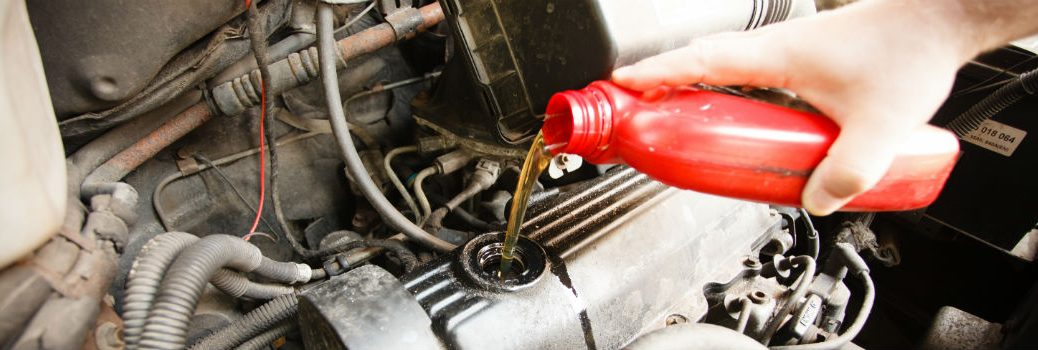 oil being poured into engine