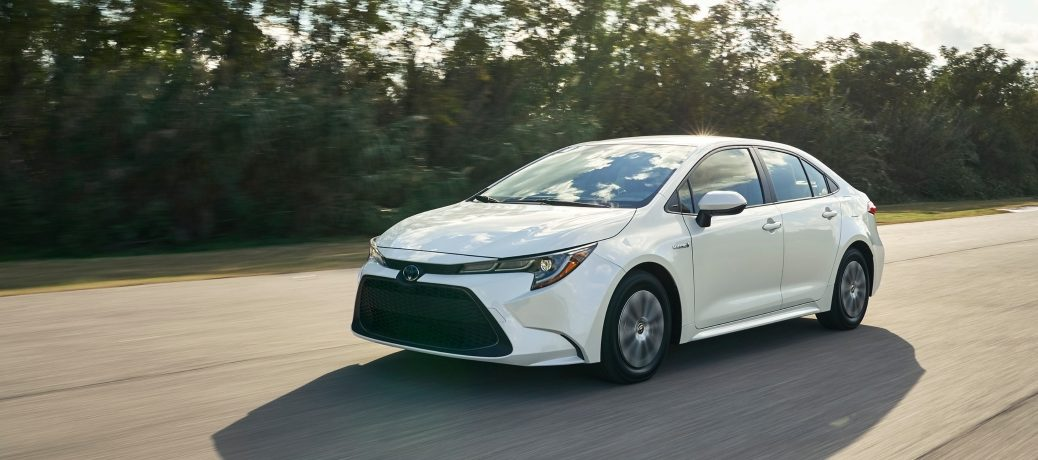white 2020 corolla driving
