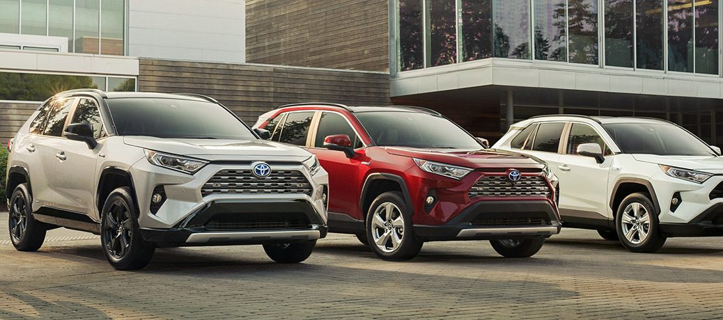 three 2019 rav4 hybrid parked