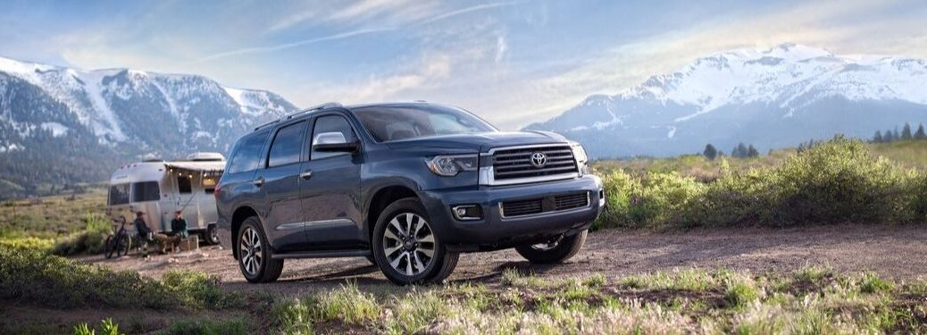 2020 Toyota Sequoia by camper in mountain landscape
