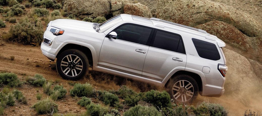 2020 Toyota 4Runner driving up dirt trail