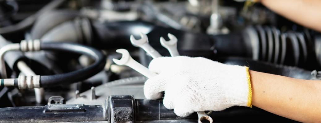 fixing a car with white glove