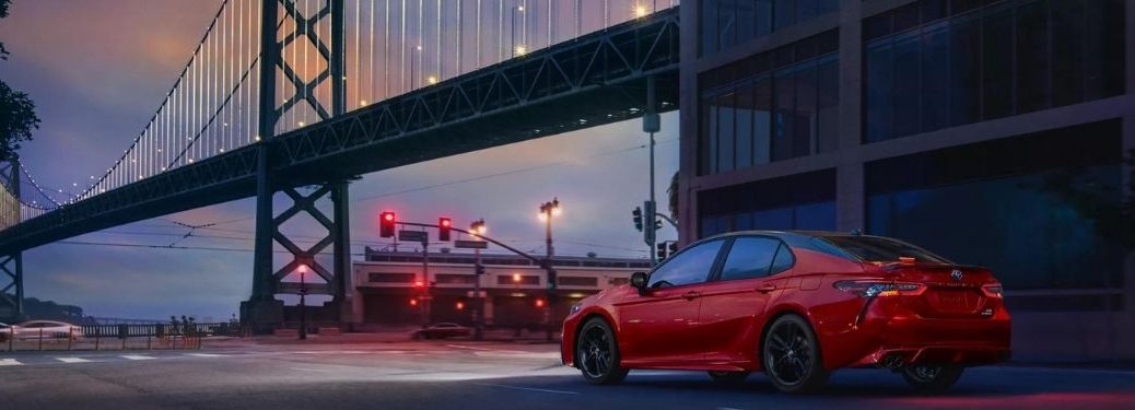 red 2022 Camry at a traffic signal