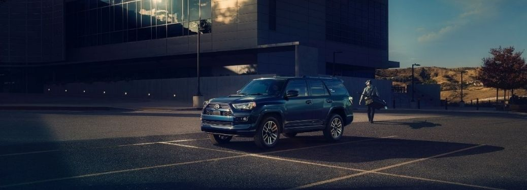 Blue 2022 Toyota 4Runner parked IN front a building complex