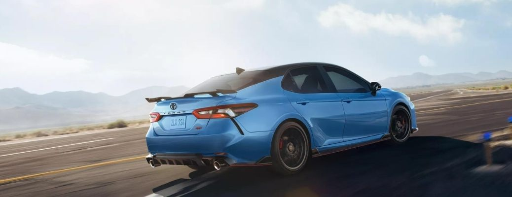 Blue 2022 Toyota Camry driving on the road