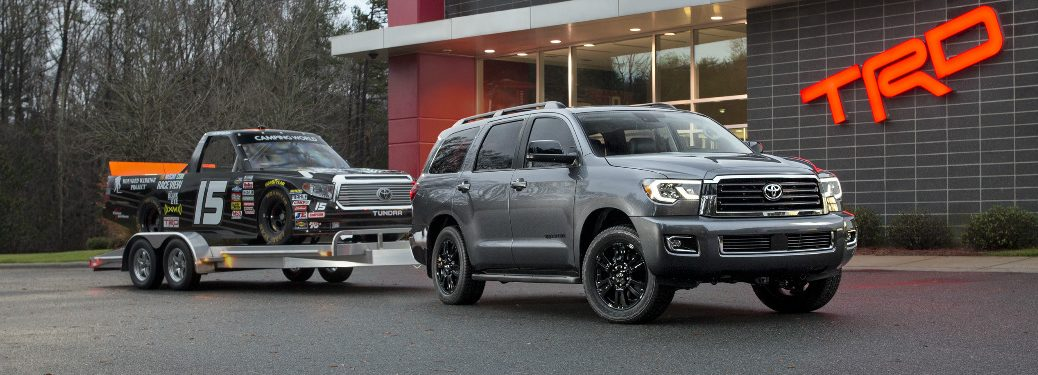 Grey 2018 Toyota Sequoia Towing a Toyota Tundra Race Truck
