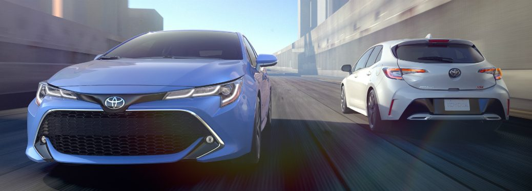 Front View of Blue 2019 Toyota Corolla Hatchback and Rear View of White 2019 Toyota Corolla Hatchback